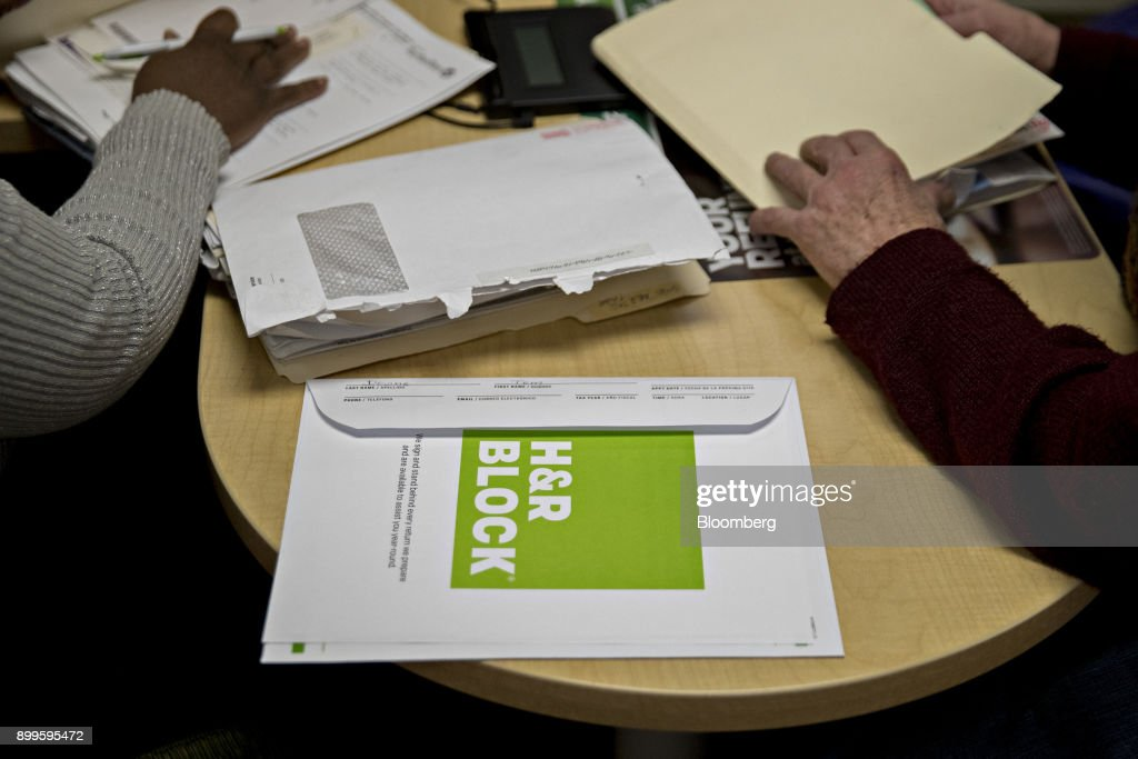 Tax preparation offices after gop tax overhaul was signed into law an envelope sits on a desk at the hr block inc tax service office in sciox Image collections
