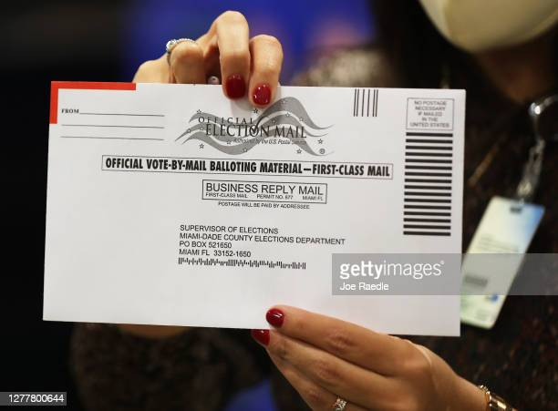 An envelope with a vote-by-mail ballot inside is shown to the media at the Miami-Dade County Election Department on October 01, 2020 in Doral,...