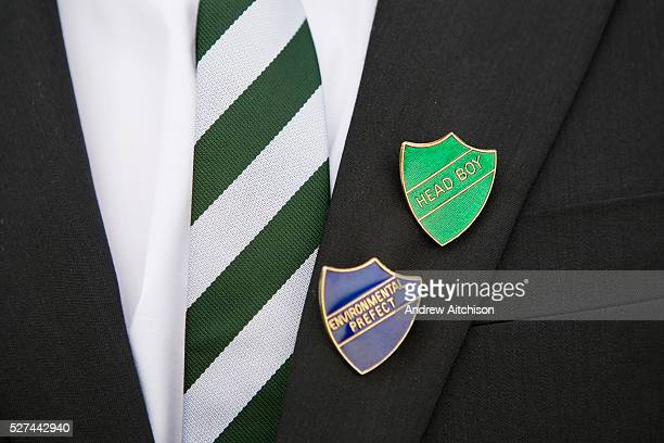 An environmental prefect and head boy shows his badges at Ringmer College in East Sussex