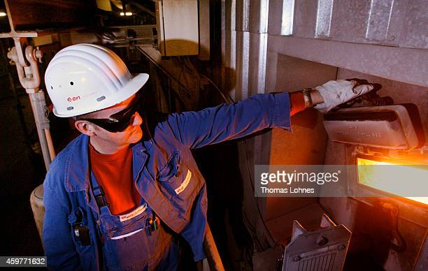 An eon employee looks into a incinerator room for coal at power station 'Staudinger' on January 31 2007 in Grosskrotzenburg near Hanau Germany...
