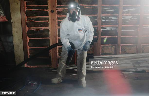 An EPA clean up crew works on extracting asbestos fibers from a farm's barn in the Libby area The EPA have cleaned thousands of homes buildings and...