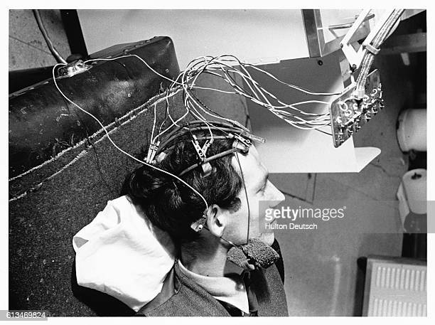 An epileptic man is attached to a encephalogram machine which can measure the electrical activity in his brain This can then be converted into graph...