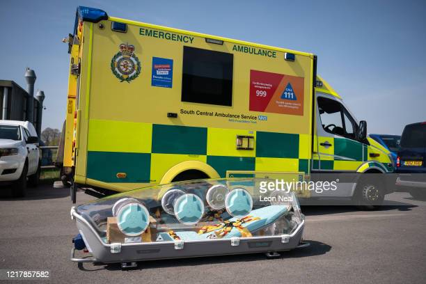 An EpiShuttle medical isolation and transportation system by EpiGuard is seen as members of the UK Armed Forces work with NHS medical staff and Air...