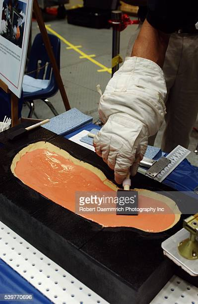 An epoxylike fill material will be used to repair damaged tiles by astronauts in space The twopart mixture will be dispensed into voids curing in one...