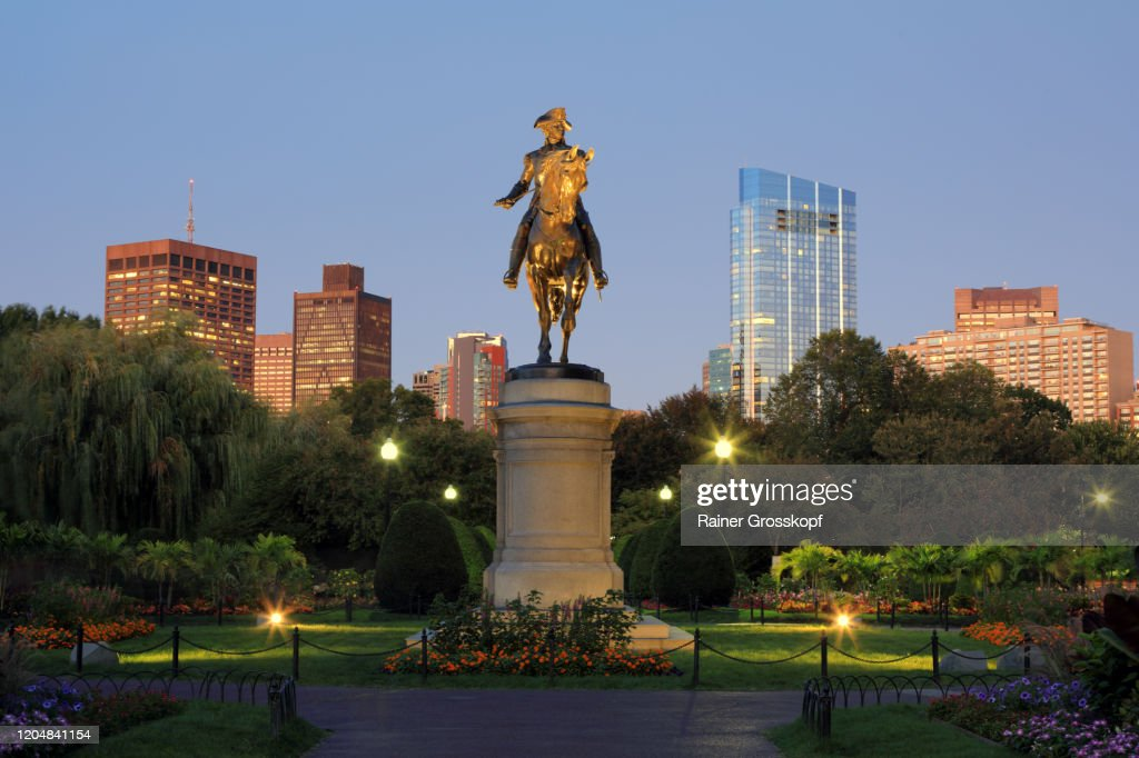 An equestrian statue of George Washington in Boston's Public Garden illuminated at dusk : Stock Photo