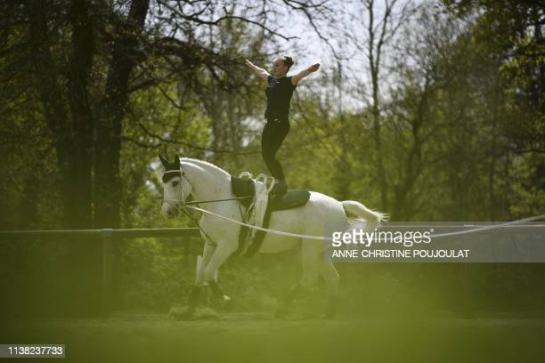 An equestrian vaulter warms-up before the FEI Vaulting World Cup final competition on April 18, 2019 in the Ecole Nationale d'Equitation Cadre Noir...