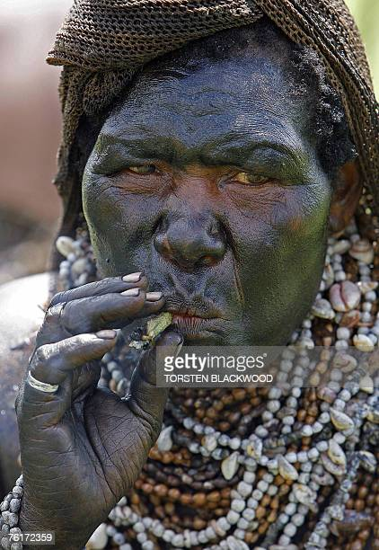 An Erima widow covered in charcoal and pig fat wears numerous strings of seeds known as 'Job's tears' during the 46th annual singsing in the frontier...