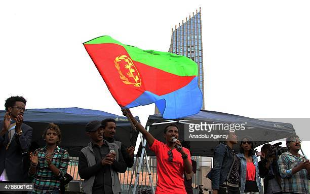 An Eritrean refugee waves an Eritrea flag during a demonstration in front of the African Union headquarters against Eritrean President Isaias...