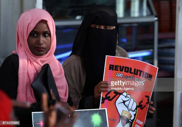 An Eritrean woman holds a banner reading Revolution Fight For Your Right during a protest for religious freedom at African Union Headquarters in...