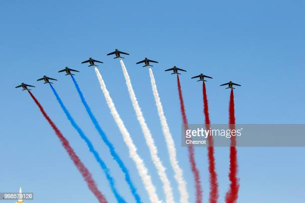 An error occurred in the colors of the French flag produced by the fumes of the 'Patrouille de France during the traditional Bastille Day military...