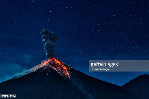 an erupting volcano in alotenango, guatemala. - volcano stock photos and pictures