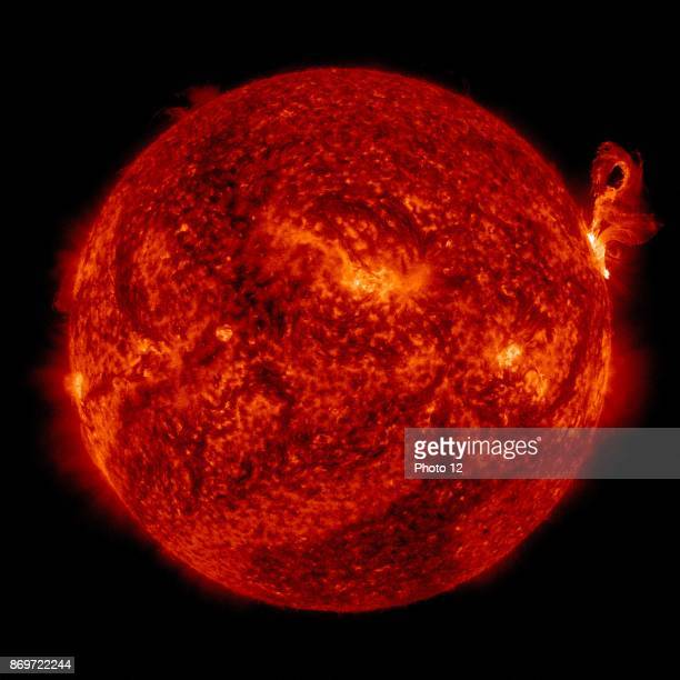 An eruption of solar material exploding up off the surface of the right side of the sun 2012