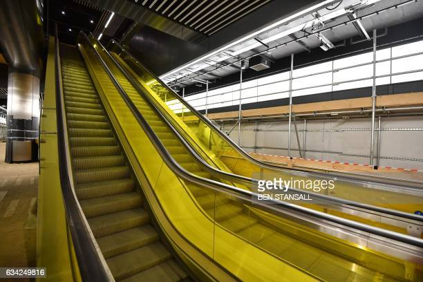 An escalator is seen on the platform of the Canary Wharf Crossrail station in London on February 8 2017 Crossrail is building a new railway for...