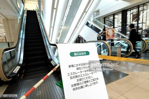 An escalator is stopped in attempt to save energy at a department store on September 10 2018 in Sapporo Hokkaido Japan Commuters hit the streets of...