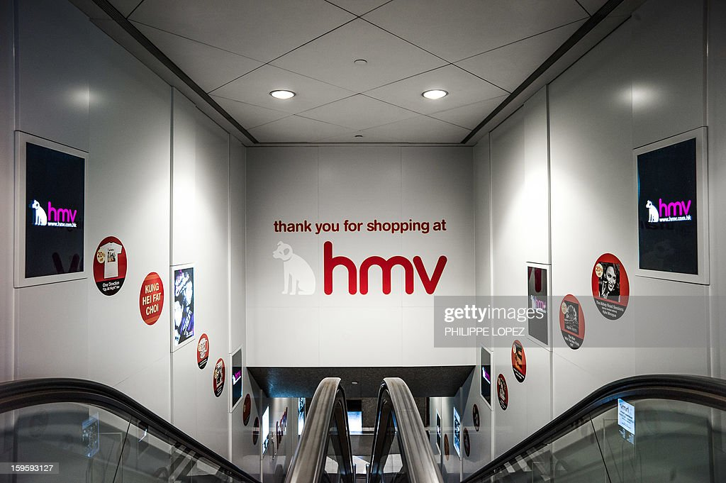 An escalator leads out of a HMV store in Hong Kong on January 17, 2013. Iconic British music retailer HMV was is fighting for survival after slumping into administration, but its boss expressed hope the high-street giant would manage to secure its future. AFP PHOTO / Philippe Lopez