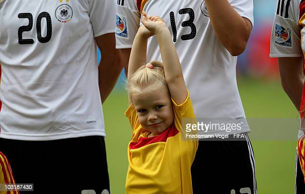 An escord kid looks on prior the FIFA U20 Women's World Cup Final match between Germany and Nigeria at the FIFA U20 Women's World Cup stadium on...