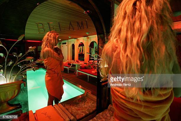 An escort girl awaits customers at Berlin's exclusive Night Club Bel Ami on May 16 2006 in Berlin Germany Escort girls across Germany are...