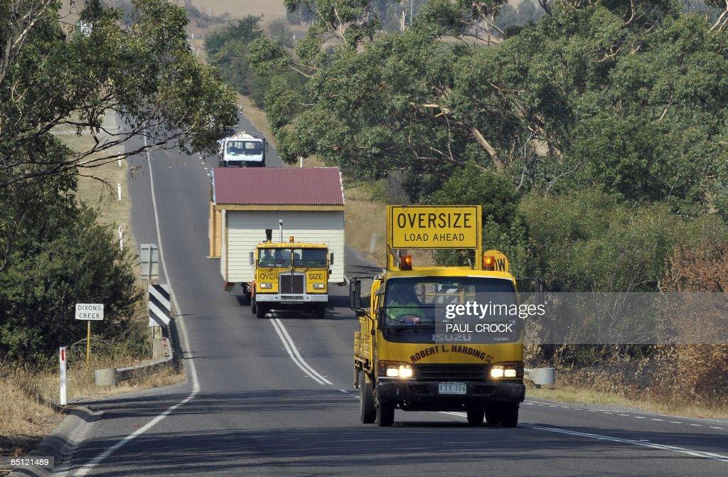 An escort vehicle warns on-coming traffi : News Photo