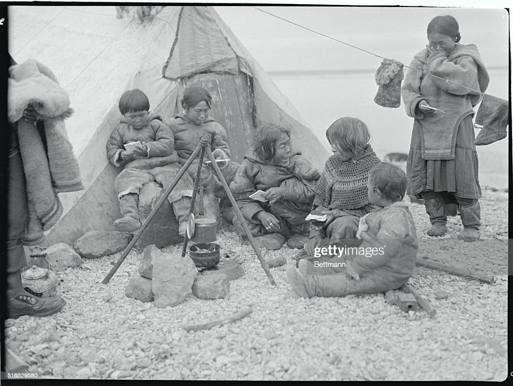 Eskimo Family Outside Tent  News Photo & An Eskimo family cooking outside their sealskin tent during summer ...
