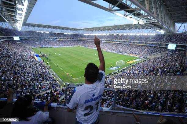 An Espanyol fan wearing the name of recent captain Daniel Jarque cheers his side before the La Liga match between Espanyol and Real Madrid at the...