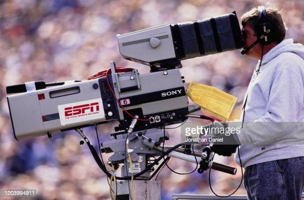 An ESPN Sports Network broadcast television cameraman using a Sony television camera during the NCAA Division I-A Big 10 college football game...