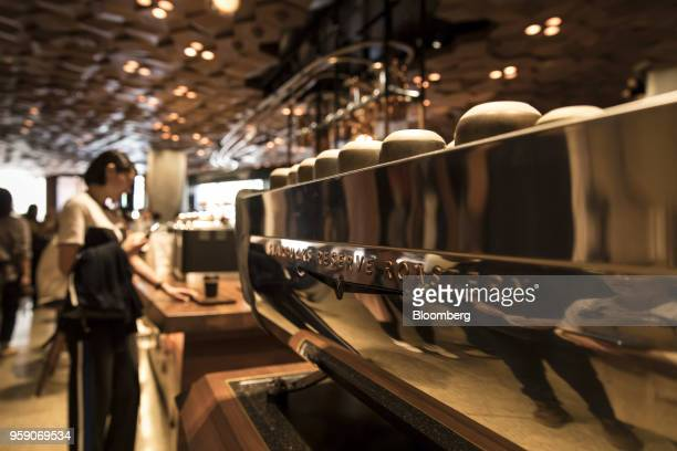 An espresso machine stands on a counter inside the Starbucks Corp Reserve Roastery store in Shanghai China on Friday May 11 2018 Starbucksis laying...