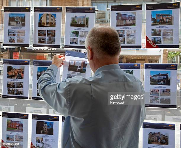 An Estate Agent changes a window display