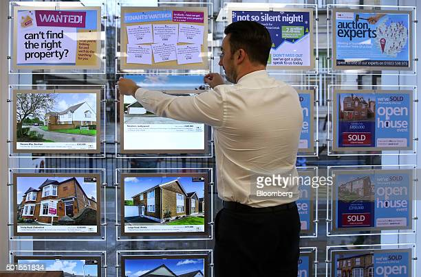 An estate agent replaces an advertisement in window of William H Brown estate agents in this arranged photograph in Chelmsford UK on Tuesday Dec 15...