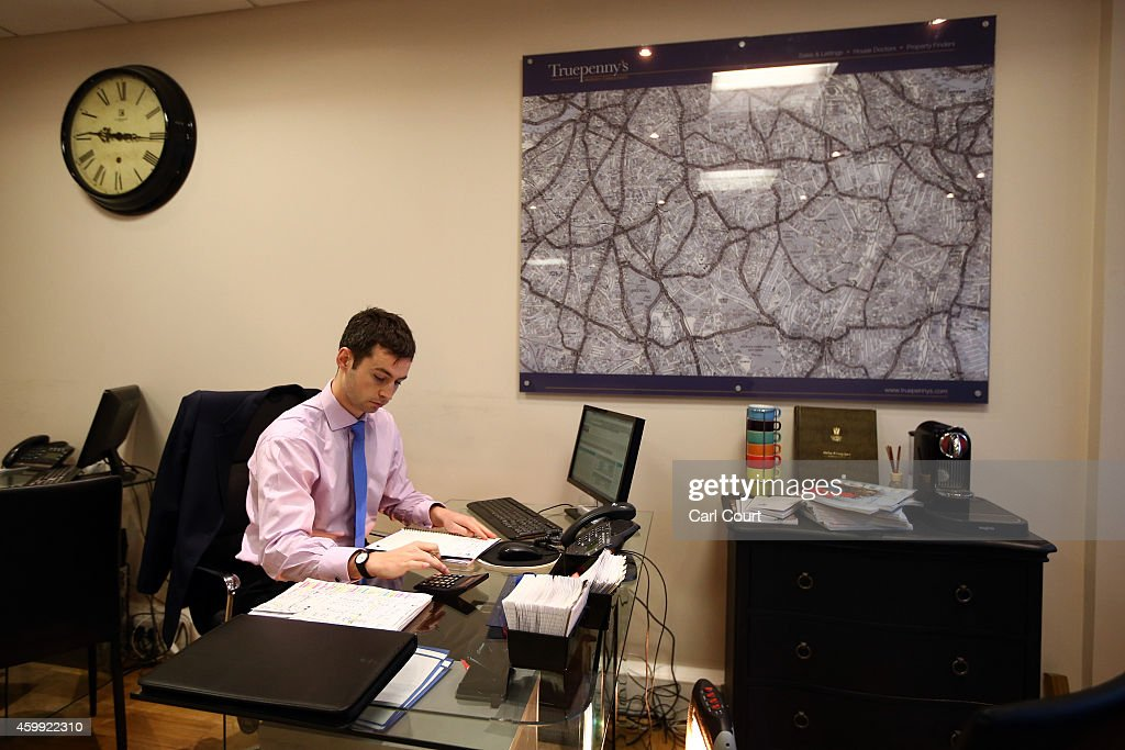 An estate agent works in his office on December 4, 2014 in in East Dulwich, London, England. In his autumn statement, Chancellor of the Exchequer, George Osborne, cut the rate of stamp duty for lower-value house sales and raised it on those worth more than £1.5m in a move that would cut the rate of tax for 98% of house purchases.