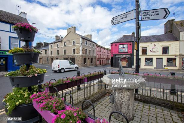 """An estate agent's board reads """"Public House For Sale"""" above the closed-down Tery's bar in the rural village of Dunmore, west of Ireland, on September..."""