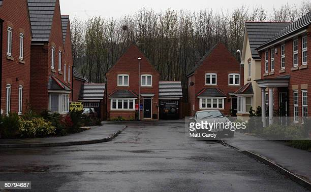 An estate agent's for sale sign is displayed outside a house in a cul de sac on April 21 2008 in Newport Wales A poll by researchers Fitch has...
