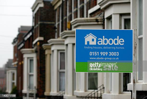 An estate agents 'For Sale' sign is displayed outside a house in Liverpool UK on Thursday Feb 23 2012 UK house prices held their value for a second...