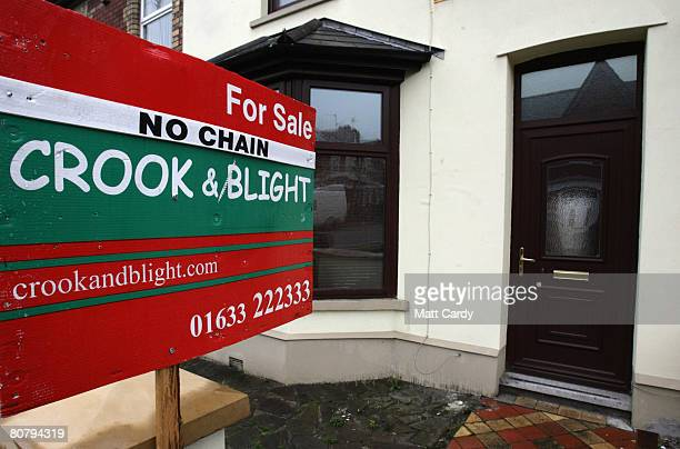 An estate agent's 'for sale' sign is displayed outside a house on April 21 2008 in Newport Wales A poll by researchers Fitch has revealed ten...