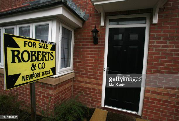An estate agent's for sale sign is displayed outside a house on April 21 2008 in Newport Wales A poll by researchers Fitch has revealed 10 subprime...