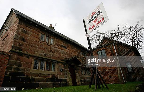 An estate agents 'For Sale' sign is displayed outside a residential property in Lymm UK on Thursday Feb 23 2012 UK house prices held their value for...