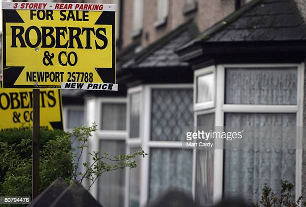 An estate agent's for sale signs are displayed outside terraced houses on April 21 2008 in Newport Wales A poll by researchers Fitch has revealed 10...