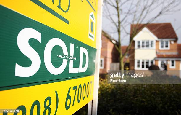 An estate agent's sign advertising a residential property as sold stands in Milton Keynes UK on Friday March 4 2011 UK house prices fell in February...