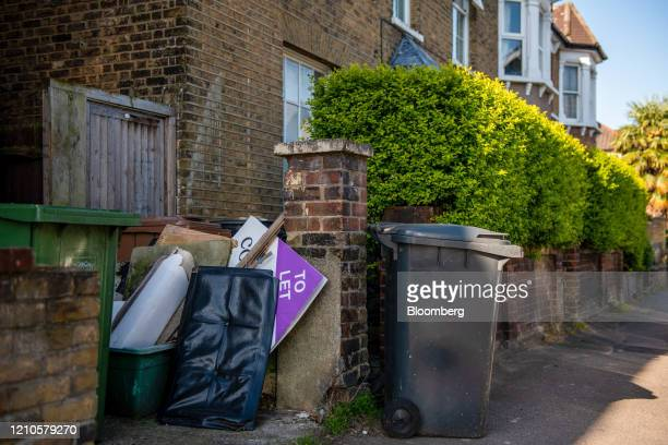 An estate agents To let sign sits near bins outside a residential property in London, U.K., on Tuesday, April 21, 2020. U.K. Real estate agents...