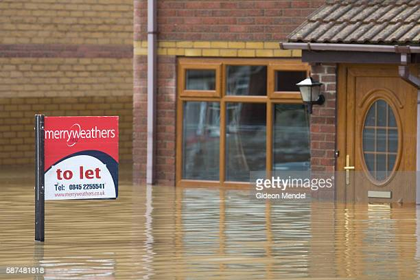 An estateagents sign advertising a house to let ironically rises above the floodwaters in Catcliffe Village This was one of the communities flooded...