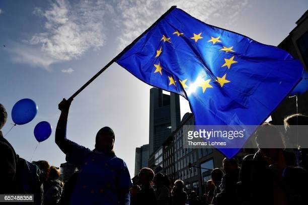 An estimated 3500 demonstrators attend a proEuropean Union rally of the 'Pulse of Europe' movement on March 12 2017 in Frankfurt Germany The movement...