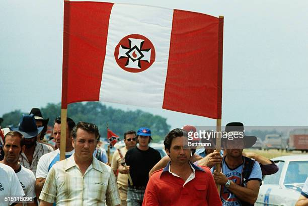 An estimated 80 Ku Klux Klansmen, led by Bill Wilkenson, Imperial Wizard of the Invisible Empire, are shown about 16 miles out of Selma along Highway...