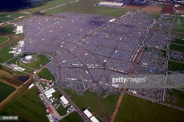An estimated 900,000 pilgrims have gathered on the Marienfeld to celebrate a vigil, a nightly mass, held by Pope Benedict XVI, on August 20, 2005...