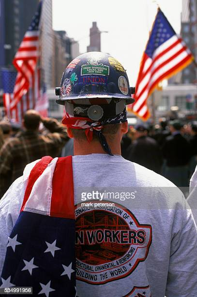 An estimated crowd of 10000 converged on Ground Zero to show support for the troops in Iraq Among the attendees were scores of firefighters...