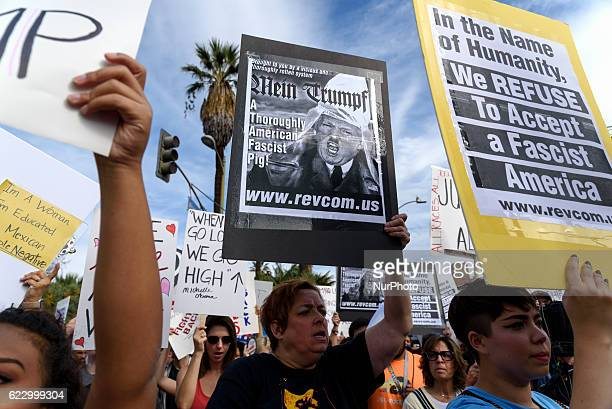 An estimated crowd of nine thousand people marched through the streets of Los Angeles in protest of PresidentElect Donald Trump Los Angeles...