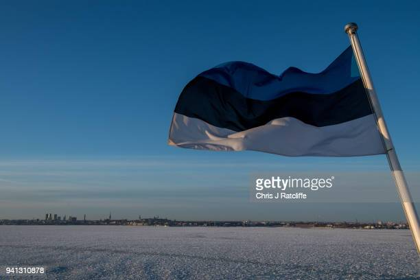 An Estonian flag flies from a ferry with Tallinn in the distance on March 30 2018 in Tallinn Estonia 2018 marks 100 years since the incorporation of...