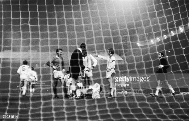 An Estudiantes de la Plata player lays in the goalmouth in an incident at Old Trafford during the World Club Championship final between the...