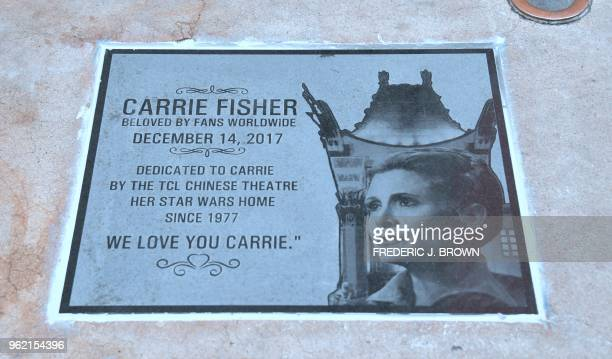 An etched granite plaque in unveiled in front of the TCL Chinese Theatre on May 24 2018 in Hollywood California in memory of the late Carrie Fisher...