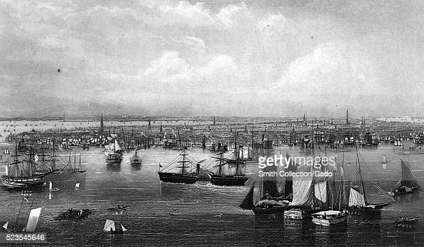 An etching from a painting of a harbor in New York, many ships of varying sizes can be seen in the harbor, they include sailing vessels, paddle...