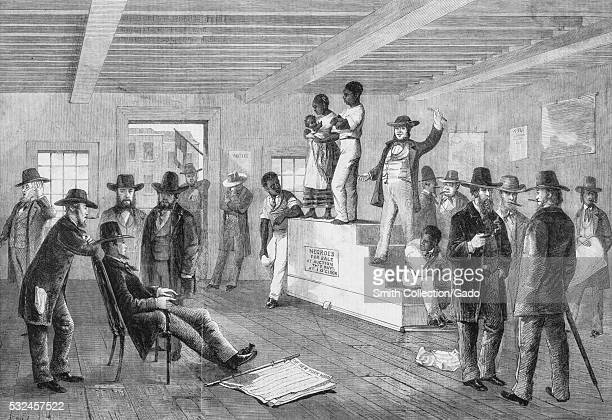 An etching from a painting of a slave auction a black man stands next to a black woman holding her child on top of a raised platform two other black...
