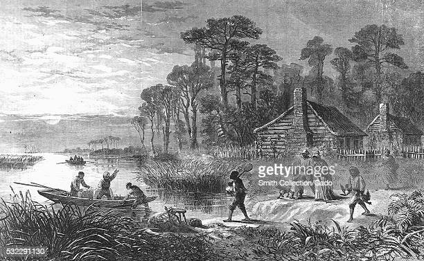 An etching from a painting of slaves loading a boat with their belongings they are in the process of escaping slavery by traveling to a free state...